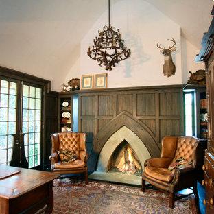 シャーロットのトラディショナルスタイルのおしゃれなホームオフィス・仕事部屋 (ベージュの壁、標準型暖炉、コンクリートの暖炉まわり) の写真