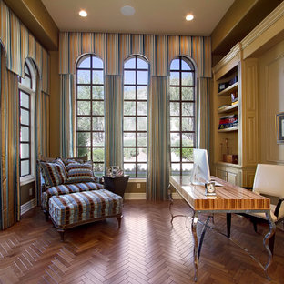 Example of a large classic freestanding desk dark wood floor study room design in Phoenix with yellow walls and no fireplace