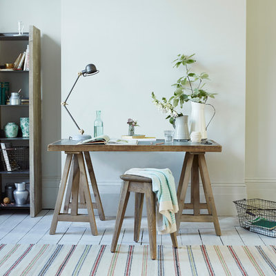 Home office - cottage freestanding desk painted wood floor home office idea in London with white walls
