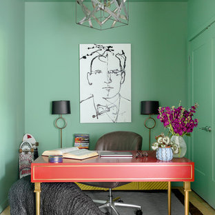 Example of a mid-sized eclectic freestanding desk dark wood floor home office design in Boston with green walls and no fireplace