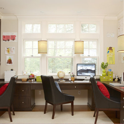 Inspiration for a large timeless built-in desk medium tone wood floor and brown floor home office remodel in Boston with white walls and no fireplace
