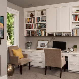 Design ideas for a medium sized traditional study in Seattle with grey walls, carpet, a standard fireplace, a metal fireplace surround, a built-in desk and beige floors.