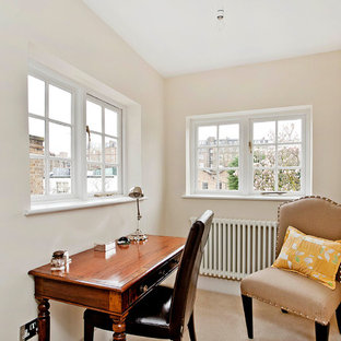 Design ideas for a small traditional study in Berkshire with beige walls, carpet, a freestanding desk and beige floors.