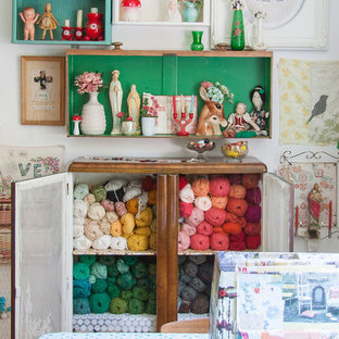 Example of a cottage chic craft room design in Seattle with white walls