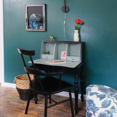 Example of an eclectic freestanding desk dark wood floor home office design in Other with blue walls