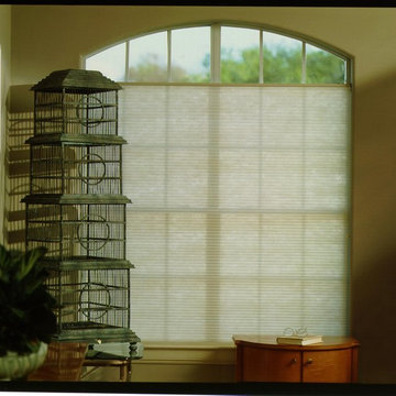 Shades cover an odd shaped window