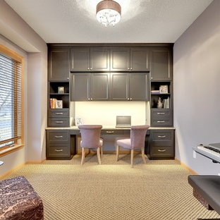 This is an example of a classic home office in Minneapolis with purple walls, carpet and a built-in desk.