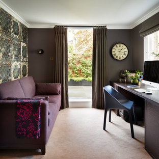 Classic home office and library in London with grey walls, carpet, a built-in desk and beige floors.