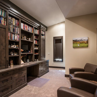 Design ideas for a large traditional home office and library in Salt Lake City with a reading nook, brown walls, terracotta flooring, no fireplace, a built-in desk and beige floors.
