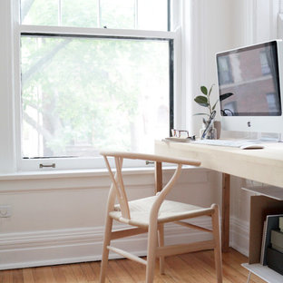 Inspiration for a mid-sized scandinavian home studio in Other with white walls, light hardwood floors and a freestanding desk.