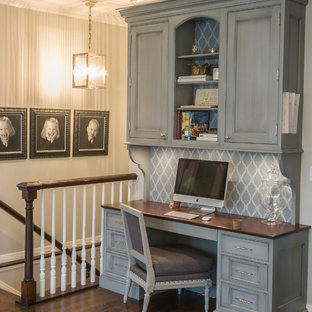 Inspiration for a large timeless medium tone wood floor home office remodel in Chicago