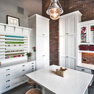 На фото: большой кабинет в стиле современная классика с местом для рукоделия, серыми стенами, полом из сланца и отдельно стоящим рабочим столом без камина