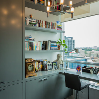 Inspiration for a mid-sized contemporary built-in desk dark wood floor study room remodel in Toronto with white walls