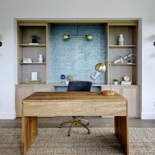Study room - scandinavian freestanding desk dark wood floor and brown floor study room idea in Austin with white walls