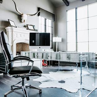 Ispirazione per un grande ufficio moderno con pareti grigie, parquet scuro, camino classico, cornice del camino in pietra, scrivania autoportante e pavimento nero