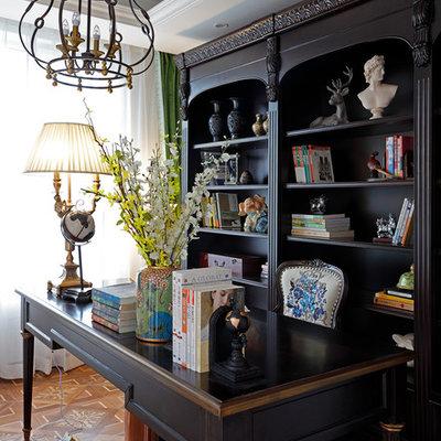 Study room - traditional freestanding desk medium tone wood floor study room idea in Other
