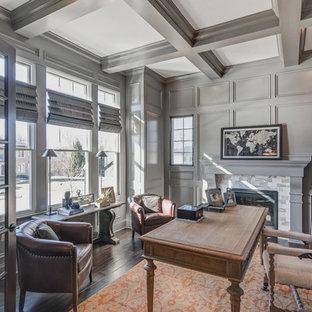 インディアナポリスの中サイズのトラディショナルスタイルのおしゃれなアトリエ・スタジオ (グレーの壁、濃色無垢フローリング、標準型暖炉、自立型机) の写真