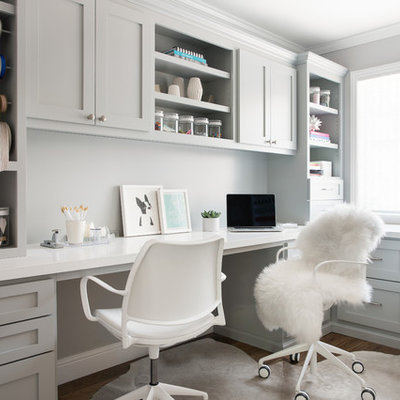 Mid-sized transitional built-in desk medium tone wood floor and brown floor craft room photo in San Francisco with gray walls