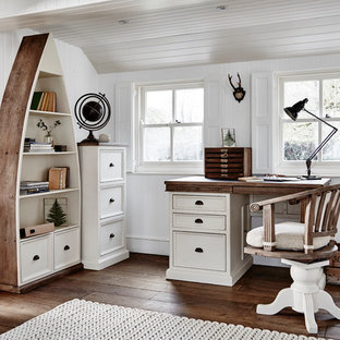 This is an example of a farmhouse study in Other with white walls, dark hardwood flooring, a freestanding desk and brown floors.