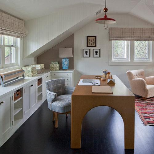 example of a coastal freestanding desk dark wood floor and brown floor home office design in