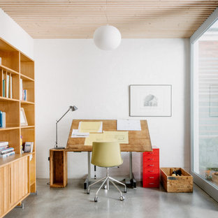 Design ideas for a contemporary study room in Melbourne with white walls, concrete floors, a freestanding desk and grey floor.