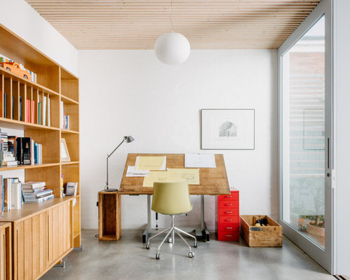 Design Ideas For A Contemporary Study Room In Melbourne With White Walls,  Concrete Floors,