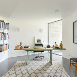 Photo of a traditional home office and library in Sussex with white walls, a freestanding desk and grey floors.