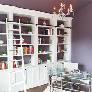 Medium sized modern home office and library in Vancouver with a reading nook, purple walls, medium hardwood flooring, no fireplace, a freestanding desk and brown floors.