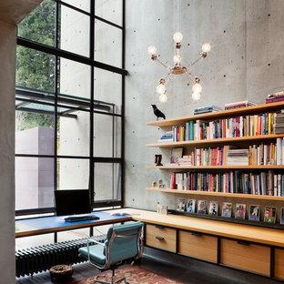 Idéer för industriella arbetsrum, med grå väggar och ett inbyggt skrivbord