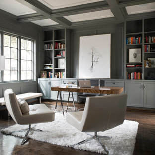 Example of a minimalist freestanding desk dark wood floor study room design in Dallas with gray walls