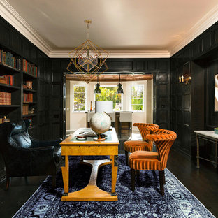 Large tuscan freestanding desk dark wood floor home office library photo in Los Angeles