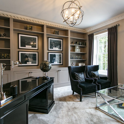 Inspiration for a large timeless freestanding desk carpeted and white floor study room remodel in Surrey with black walls