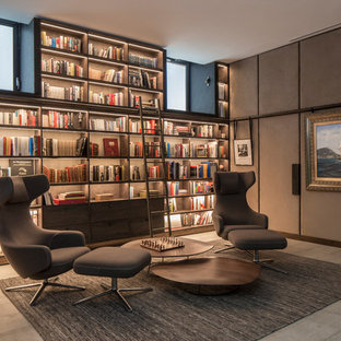 ロンドンの中くらいのモダンスタイルのおしゃれなホームオフィス・書斎 (ライブラリー、グレーの壁、グレーの床) の写真