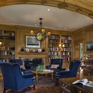Elegant freestanding desk dark wood floor home office photo in Philadelphia
