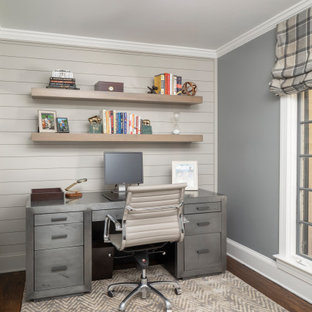Example of a transitional home office design in Charlotte