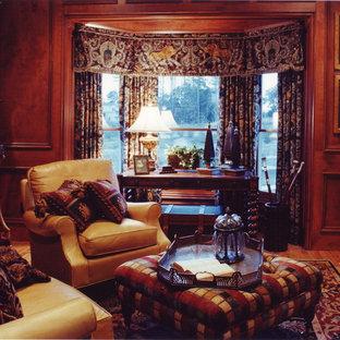Ispirazione per un grande studio chic con pareti marroni, pavimento in legno massello medio, camino classico, cornice del camino in legno e scrivania autoportante