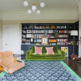 ケントのトランジショナルスタイルのおしゃれなホームオフィス・書斎 (ライブラリー、ベージュの壁、濃色無垢フローリング、薪ストーブ) の写真
