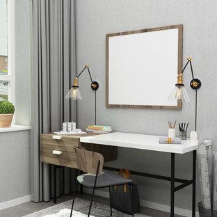 アトランタの小さいトランジショナルスタイルのおしゃれな書斎 (青い壁、合板フローリング、自立型机、グレーの床) の写真