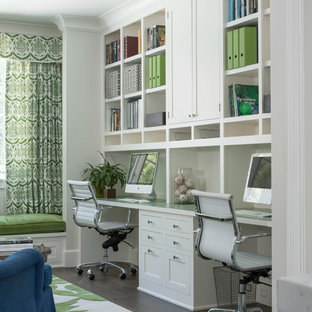 Study room - mid-sized transitional built-in desk dark wood floor study room idea in San Francisco with white walls