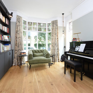 Traditional home office in Manchester with a reading nook, grey walls, light hardwood flooring and beige floors.