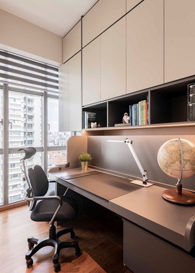 Contemporary Home Office & Library by ERStudio Pte Ltd