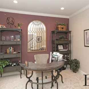 Classic study in Boston with purple walls, carpet, a freestanding desk and beige floors.