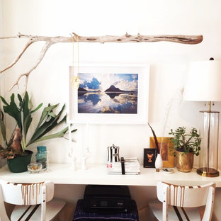 Eclectic home office photo in New York with white walls