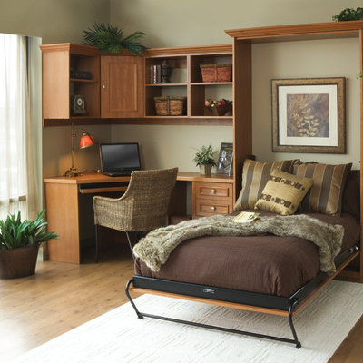 Inspiration for a mid-sized contemporary built-in desk light wood floor study room remodel in Orange County with beige walls and no fireplace