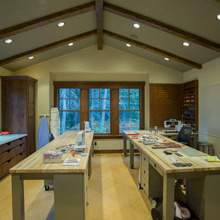 Example of a mountain style freestanding desk craft room design in Seattle with beige walls