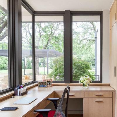 Mid-sized trendy built-in desk light wood floor study room photo in Dallas