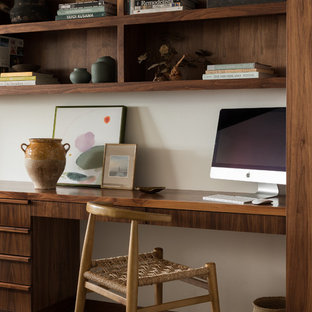 Midcentury modern built-in desk gray floor home office photo in Seattle with white walls