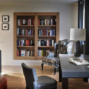 This is an example of a medium sized classic study in Surrey with grey walls, a freestanding desk and beige floors.