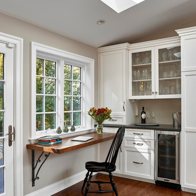 Example of a small classic built-in desk medium tone wood floor study room design in Philadelphia with gray walls