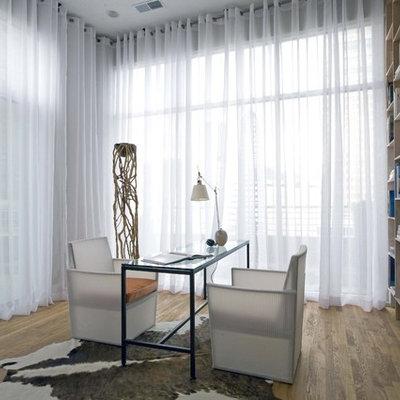Home office - contemporary freestanding desk medium tone wood floor home office idea in Birmingham